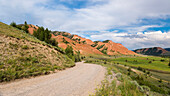 Gravel road along the Red Hills, Bridger Teton National Forest, Wyoming, USA