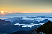 Sunrise above lake Chiemsee and Chiemgau Alps, with fog in valley of Inn, from Hochmiesing, Hochmiesing, Mangfall Mountains, Bavarian Alps, Upper Bavaria, Bavaria, Germany