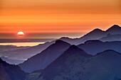 Sunrise above lake Chiemsee and Chiemgau Alps, from Seebergkopf, Mangfall Mountains, Bavarian Alps, Upper Bavaria, Bavaria, Germany