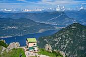 Hut rifugio Rosalba and lake lago di Como, from Grignetta, Grigna, Bergamasque Alps, Lombardy, Italy