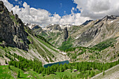 View towards mountain lake and Cottian Alps, Val Maira, Cottian Alps, Piedmont, Italy
