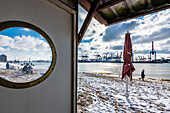 Elbe Beach in winter with view at the container port Burchardkai, Hamburg, Germany