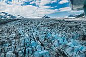 flying above the glaciers of the Alaska Mountain Range, Alaska, USA