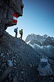 two women hiking in underneath Hahnkampl, Lamsenspitze in the back ,  Eastern Karwendel Range, Tyrol, Austria