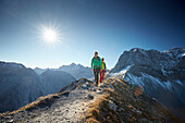 Two women hiking on the path to Sonnjoch, Lamsenspitze in the back,  Eastern Karwendel Range, Tyrol, Austria