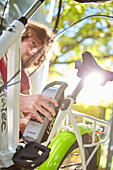 young man mounts Battery to an eBike, Muensing, bavaria, germany
