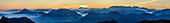 Panorama with silhouettes of Traunstein, Hoellengebirge range, Salzkammergut, Zwiesel, Hochthron, Rauschberg, Dachstein, Hoher Goell, Watzmann, Hochkalter and Hocheisspitze, from Hochfelln, Chiemgau Alps, Upper Bavaria, Bavaria, Germany