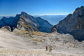 Several persons ascending through rocky cirque towards Lamsenspitze, Hochnissl in background, Lamsenspitze, Natural Park Karwendel, Karwendel range, Tyrol, Austria