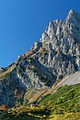 Hut Ackerlhuette beneath rock walls of Kaiser, Wilder Kaiser, Kaiser range, Tyrol, Austria
