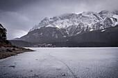 snowfall at frozen Eibsee lake below Zugspitze mountain, Grainau community, Garmisch-Partenkirchen, Bavaria, Alps, Germany