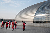 group of dressed dancers perform in front of National Centre for the Performing Arts, National Grand Theatre, Beijing, China, Asia, Architect Paul Andreu