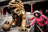 Chinese woman touches Dragon sculpture in hope for good luck, the Forbidden City, Beijing, China, Asia, UNESCO World Heritage