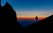 Young woman looking down to the valley, silhouette, after sunset, Scheffauer, Wilder Kaiser, Tyrol, Austria