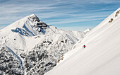 Skier enjoys an untracked snow slope in the Lechtal Alps, Namlose Wetterspitze, Lechtal Alps, Tyrol, Austria