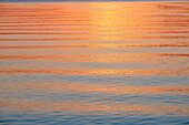 Refection of evening sky on water surface, Ambach, Lake Starnberg, bavaria, germany