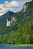 Lake Alpsee with castle Neuschwanstein, Lechweg, Ammergau Alps, Swabia, Bavaria, Germany
