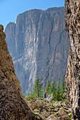 Woman hiking between rock spires towards fixed-rope route Pisciadu, fixed-rope route Pisciadu, Sella range, Dolomites, UNESCO World Heritage Site Dolomites, South Tyrol, Italy