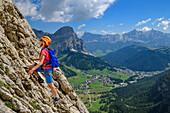 Woman climbing fixed-rope route Pisciadu, fixed-rope route Pisciadu, Sella range, Dolomites, UNESCO World Heritage Site Dolomites, South Tyrol, Italy