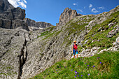 Woman finishing fixed-rope route Pisciadu, fixed-rope route Pisciadu, Sella range, Dolomites, UNESCO World Heritage Site Dolomites, South Tyrol, Italy