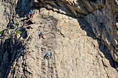 Three persons climbing at Aiguille Dibona, hut Refuge du Soreiller, Ecrins, National Park Ecrins, Dauphine, Dauphiné, Hautes Alpes, France