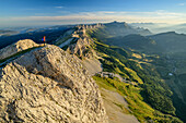Woman while hiking on the mountains of the Vercors looks with mouche role in the background, from the Grand Veymont, Vercors, Dauphine, Dauphine, Isère, France