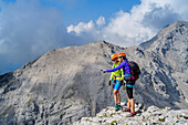Consider two women on a via ferrata mountain landscape, donkey stone, the Dachstein, Styria, Austria