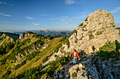 Woman while hiking rises to Aiplspitze, Aiplspitze, Mangfall Mountains, the Bavarian Alps, Upper Bavaria, Bavaria, Germany