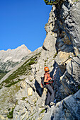 Mrs rises above the via ferrata to bettelwurf, Absamer via ferrata, bettelwurf, Karwendel, Tyrol, Austria