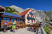 Several people on the terrace of the Hut, Hut, Hut Bettelwurf Bettelwurf bettelwurf, Karwendel, Tyrol, Austria