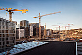 view from rooftop of Opera House at the area named BARCODE, construction site and plenty of tower cranes, Oslo, Norway, Scandinavia, Europe