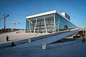 people sit and walk at roof of opera, the New Opera House in Oslo, Norway, Scandinavia, Europe