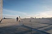 few people walk at roof of opera, the New Opera House in Oslo, Norway, Scandinavia, Europe