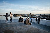 predominantly young people enjoy view from Opera at the surrounding Oslofjord, the New Opera House in Oslo, Norway, Scandinavia, Europe