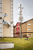 still-life of satellite dishes, power poles and colourful houses, Houston, Texas, US, United States of America, North America