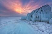Ice mountain at sunrise at lake Baikal, Irkutsk region, Siberia, Russia.