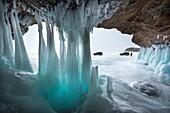 Ice stalactites in a cave at the shore at lake Baikal, Irkutsk region, Siberia, Russia.