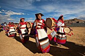 Indigenous people with traditional costumes during a performance at the Inti Raymi Festival in Saqsaywaman Archaeological Site, Cusco, Peru, South America.