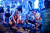Greece, Crete, Chersonissos, couple dancing at Beach Party, flirting