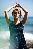 Woman at beach in holiday destination Chersonissos, Crete, Greece, sensual, breeze, holiday