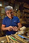 Jan Zieder, woodcarver in his workshop, village of Chocholow, Podhale region, Malopolska Province (Lesser Poland), Poland, Central Europe.