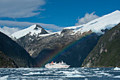 A rainbow forms over expedition cruise ship MS Hanseatic (Hapag-Lloyd Cruises), Garibaldi Glacier, near Beagle Canal, Alberto de Agostini National Park, Magallanes y de la Antartica Chilena, Patagonia, Chile, South America
