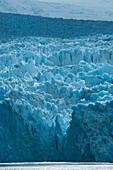 Sunlight lights up a section of the craggy glacier, Garibaldi Glacier, near Beagle Canal, Alberto de Agostini National Park, Magallanes y de la Antartica Chilena, Patagonia, Chile, South America