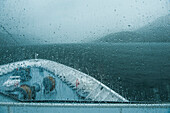 A rainy day as seen from the bridge of the expedition cruise ship MS Hanseatic (Hapag-Lloyd Cruises) traveling the Chilean fjords, Kirke Narrows, Magallanes y de la Antartica Chilena, Patagonia, Chile, South America