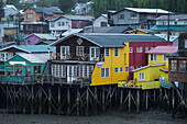 Colorful wooden stilt-houses (palafitos) along the Fiordo de Castro, Castro, Chiloe Island, Los Lagos, Patagonia, Chile, South America