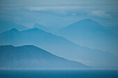 Coastal mountains seem to overlap in various shades of blue, near Trujillo, La Libertad, Peru, South America