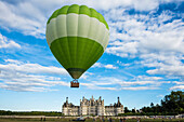 Chambord Castle and hot air balloon, North Facade, UNESCO World Heritage Site, Chambord, Loire, Department Loire et Cher, Centre Region, France