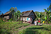 local people and typical houses in the highlands of Madagascar, Africa