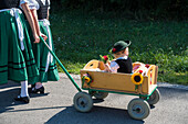 little girl in costume in cart, Upper Bavaria, Germany, Europe