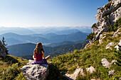 young woman enjoying panoramic view from Benediktenwand mountain, Upper Bavaria, Alps, Germany, Europe