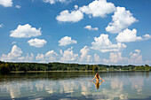 Young woman bathin in lake Ostersee, Upper Bavaria, Germany, Europe
